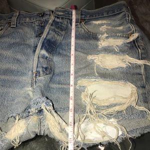 "Levi's distressed cut off jean shorts: 32"" or L"